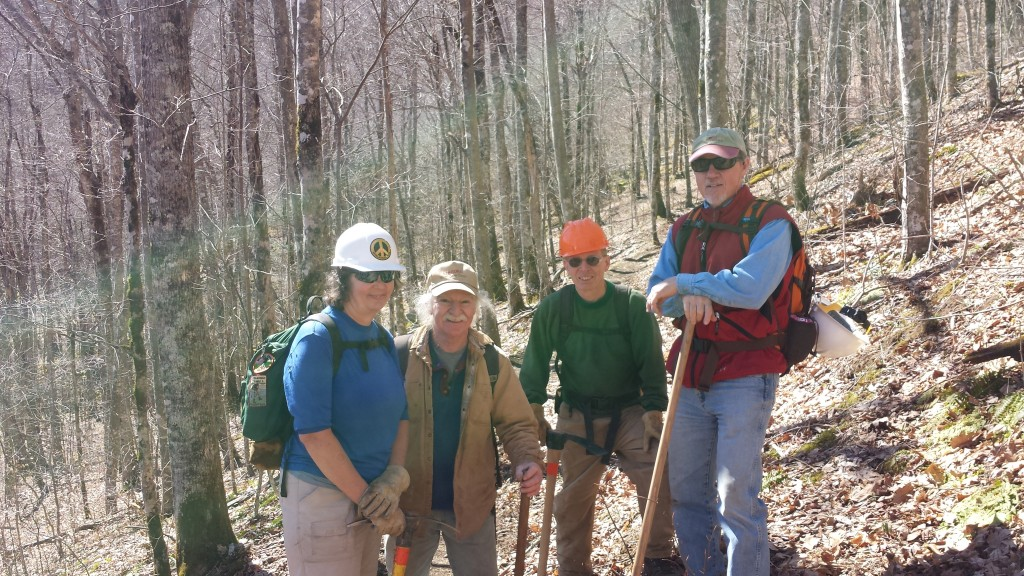 "Trail legend Bob Peoples (second from left) pictured with a small part of his volunteer trail maintenance crew. Shelters in this area feature fun Bob Peoples graffiti, such as: ""every time Bob Peoples makes a switchback, another angle gets his wings"""