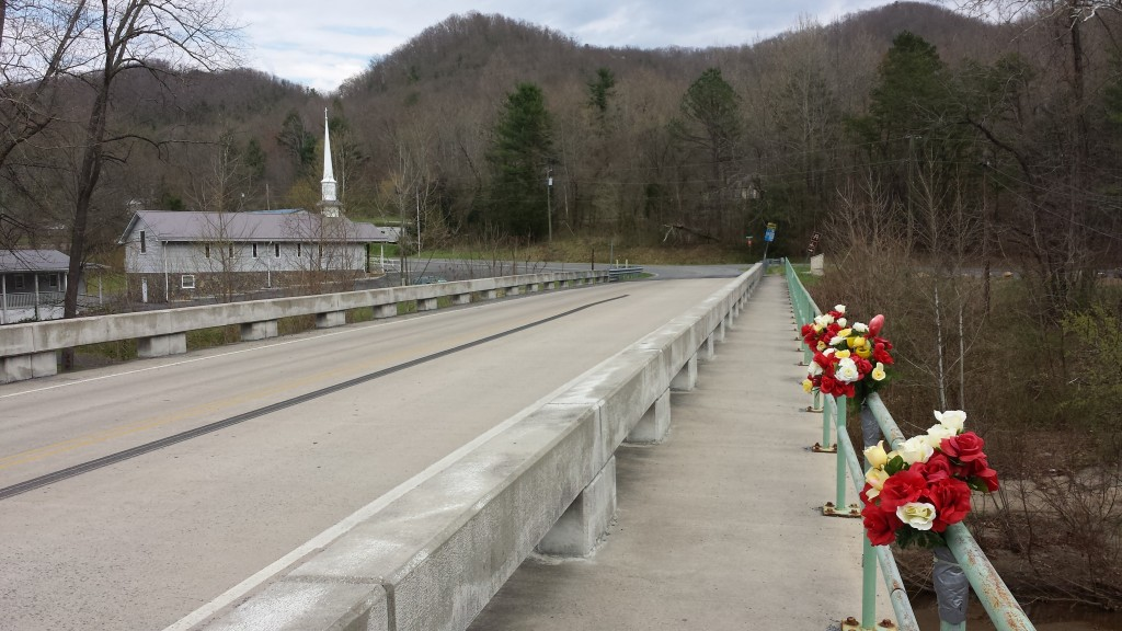 Memorial flowers on AT bridge