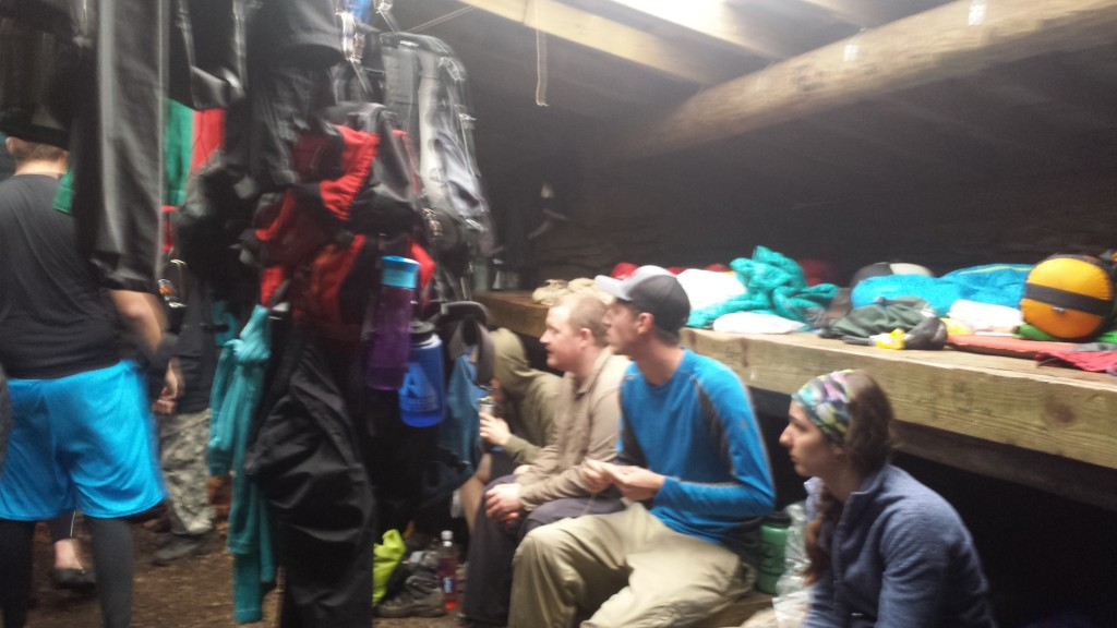 20 plus people hiding from cold rain in a shelter