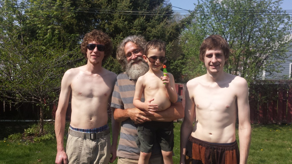 Back in Minnesota enjoying a Sunday waterfight: two of our brood (Jerry and Art) with me holding grandson Jack